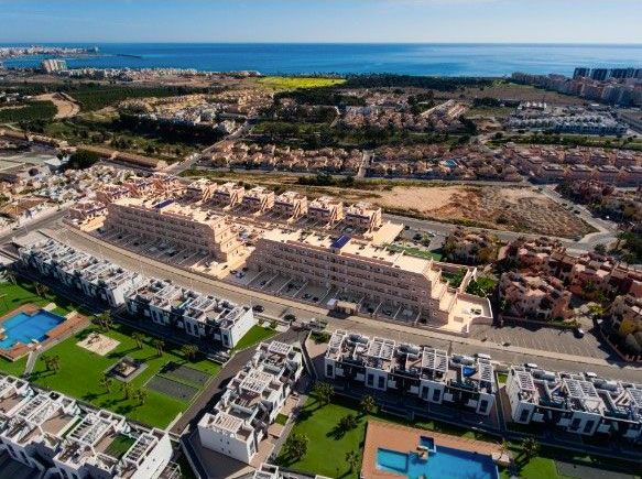 Apartments and townhouses in urbanization with pool, spa, gym, in Punta Prima. 10