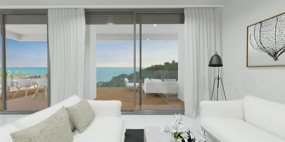 Living room with direct access to the terrace, sea and mountain views in Calpe. Buy house Sonneil.