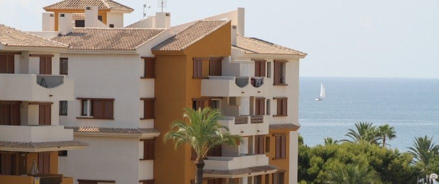 3 bedroom apartment with terrace and communal pool, Punta Prima. 1