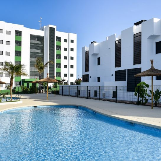 2 and 3 bedroom apartments and townhouses with large terraces and community swimming pool